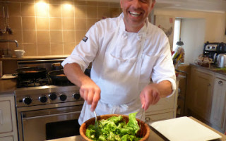 Chef Ronald prepares salad avec Chevre chaud and puff pastry